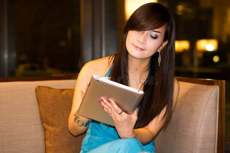 Asian woman using ipad