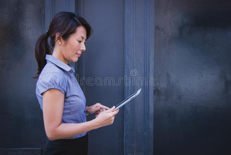Asian Woman Using A Tablet Free Public Domain Cc0 Image