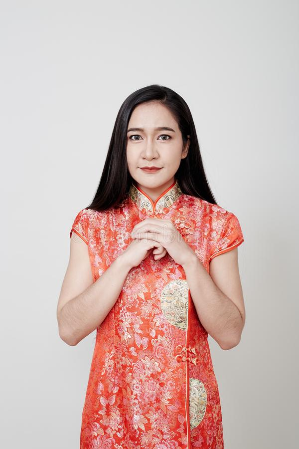 Asian woman wear cheongsam in chinese new year stock photos