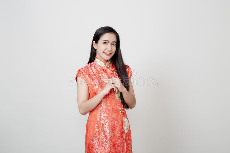 Asian woman wear cheongsam in chinese new year stock images