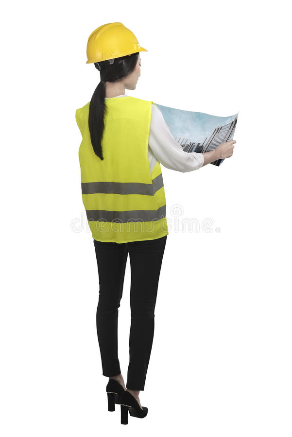 Asian woman wear had hat and safety vest looking blueprint stock photography