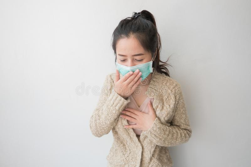 Asian women wear health masks to prevent germs and dust. Thoughts about health care. Asian woman wear health masks to prevent germs and dust. Thoughts about royalty free stock photo