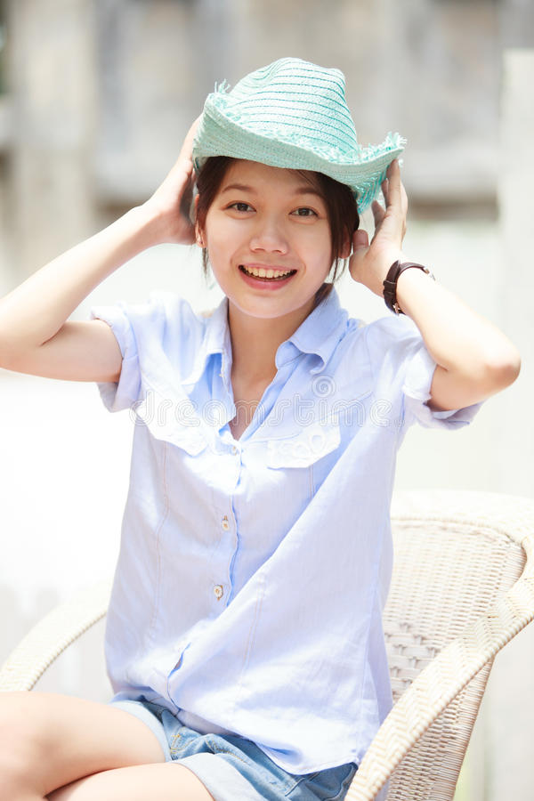 Download Asian Woman Wearing A Blue Hat With Smiling Face Stock Photo - Image: 25923294
