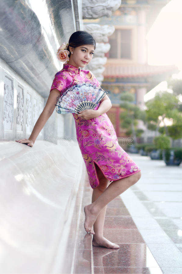 Asian woman wearing a cheongsam royalty free stock image