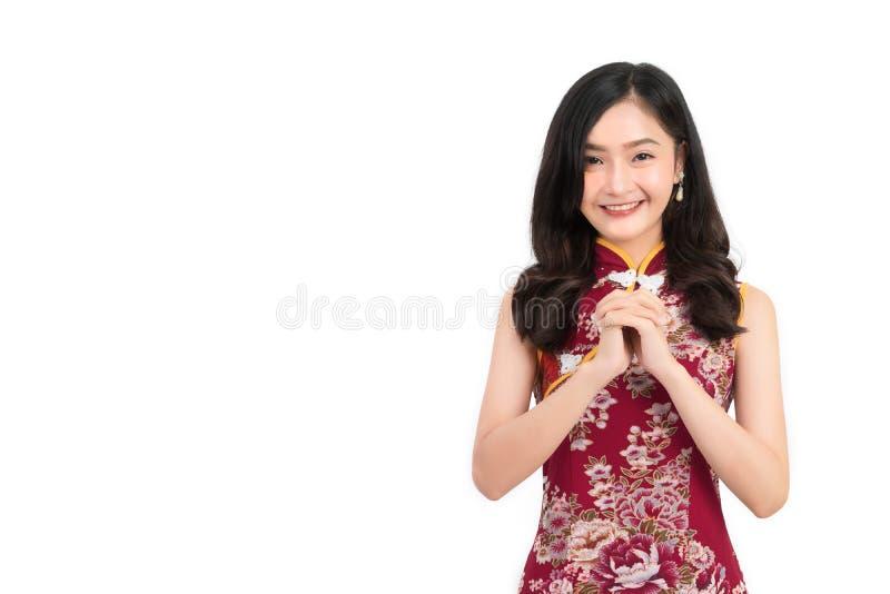 Asian woman wearing chinese dress congratulation or cheongsam,qipao smile royalty free stock photo