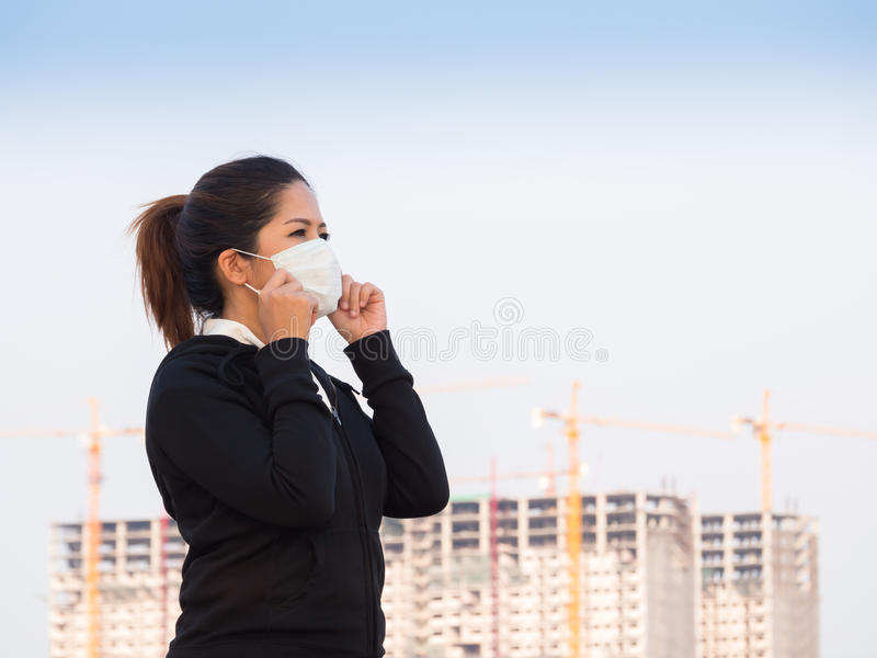 Asian woman wearing face mask. With construction background stock photos