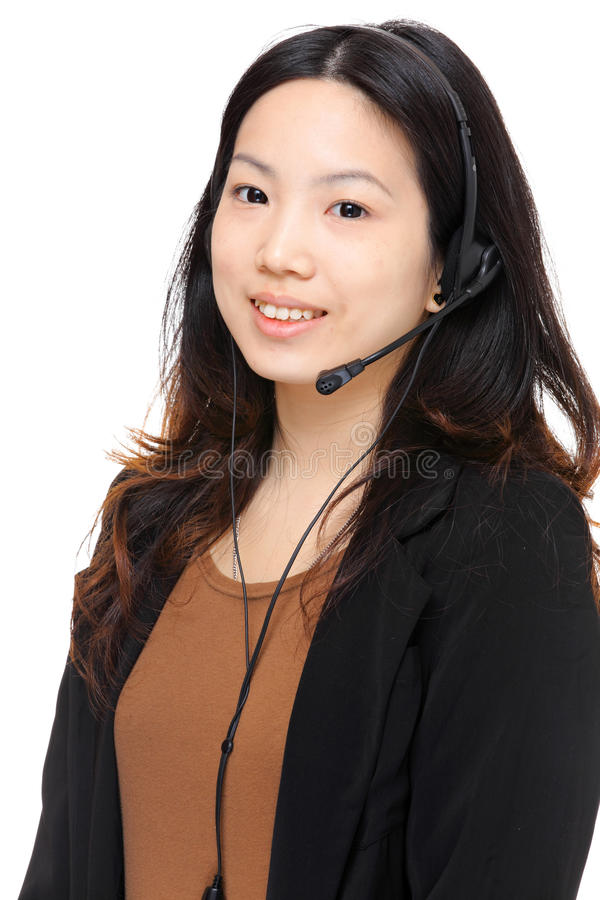 Asian woman wearing headset. Over white background stock image