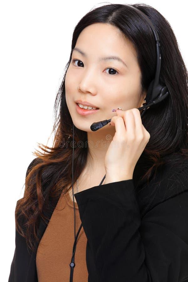 Asian woman wearing headset. Business asian woman wearing headset royalty free stock photos