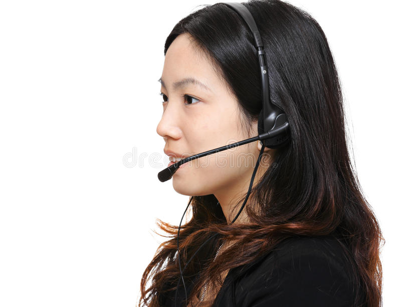 Asian woman wearing headset. Over white background royalty free stock photography