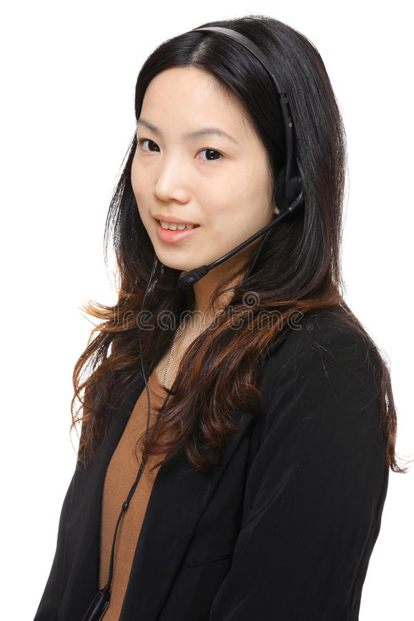 Asian woman wearing headset. Over white background royalty free stock image