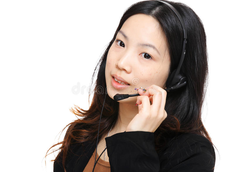Asian woman wearing headset. With white background royalty free stock photos