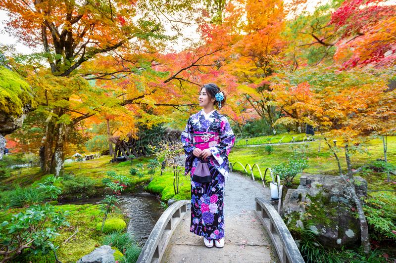 Asian woman wearing japanese traditional kimono in autumn park. Japan stock images