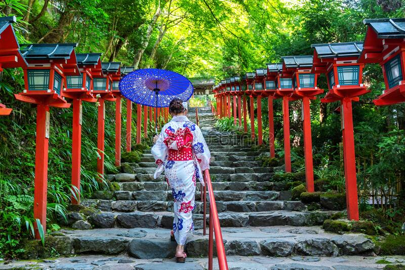 Asian woman wearing japanese traditional kimono at  Kifune Shrine in Kyoto, Japan. royalty free stock images