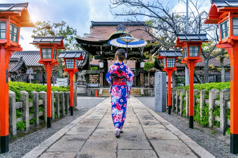 Asian woman wearing japanese traditional kimono at Kyoto temple in Japan. stock images