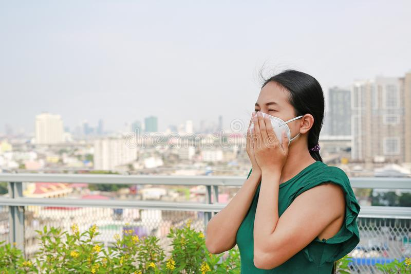 Asian woman wearing a protection mask against PM 2.5 air pollution in Bangkok city. Thailand stock photos