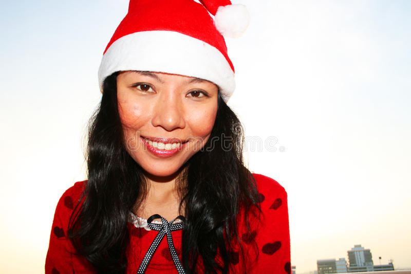 Download Asian Woman Wearing A Santa Hat. Stock Image - Image: 17311177