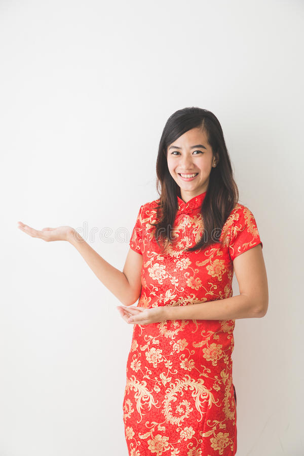 Asian woman wearing traditional chinese dress presenting stock images