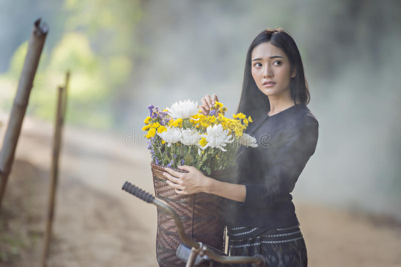 Asian woman wearing traditional thai culture,walking to go home on field stock images