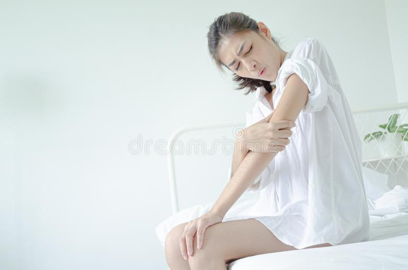 Sick woman with pain stock photography
