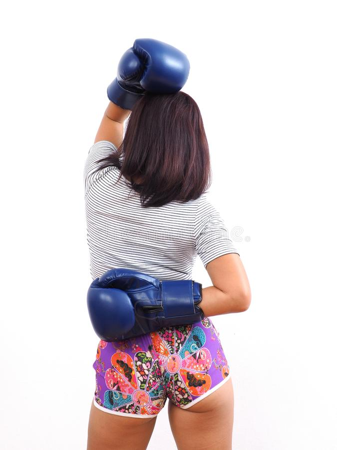 Rear shot of woman with boxing gloves stock photos