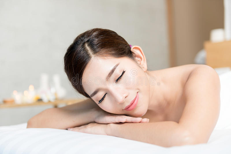 Asian woman in wellness beauty spa having aroma therapy massage with essential oil, Thailand royalty free stock photo