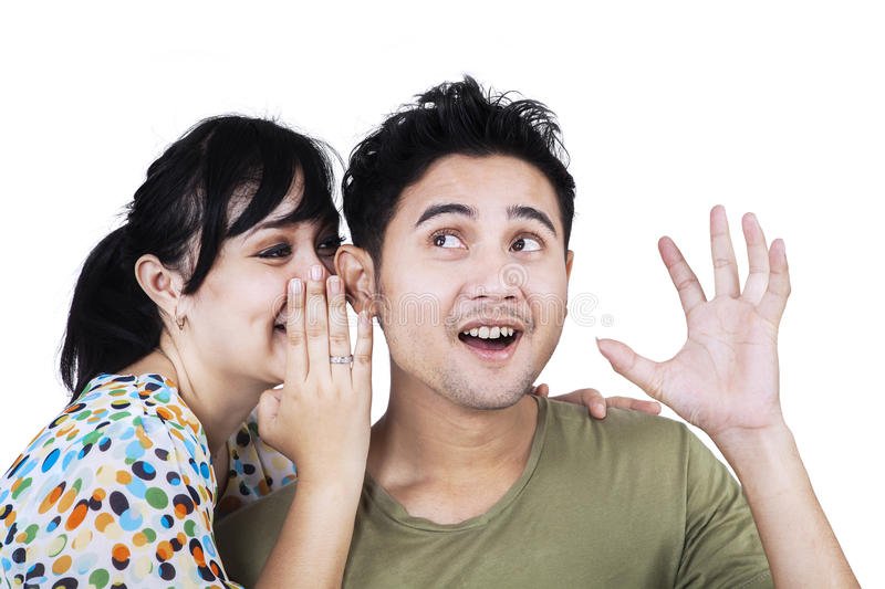 Asian woman whispering a secret news stock photography