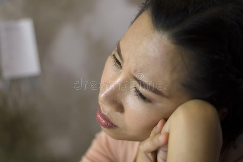 Asian woman worker suffering from hurt,fatigue, pain at neck, muscle, stressed during working with laptop for a long time, Office. Asian woman worker suffering royalty free stock images