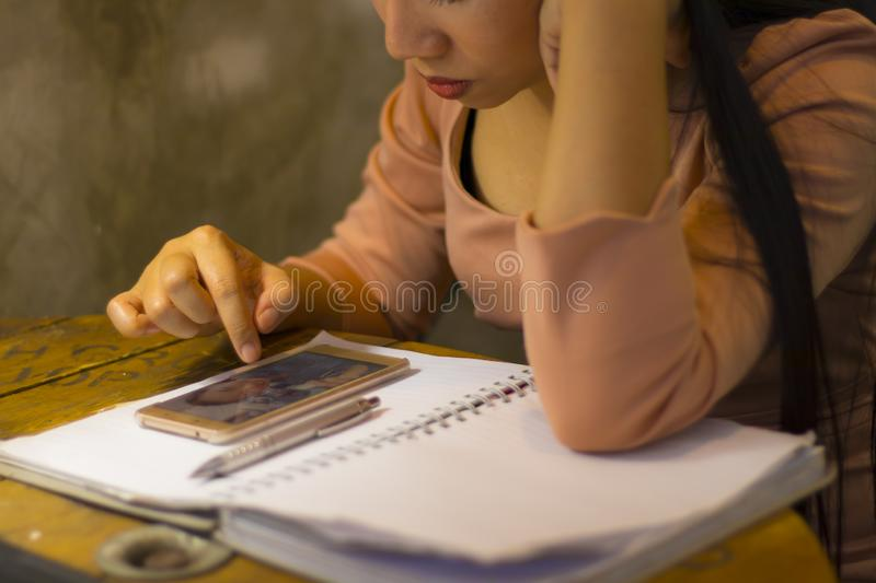 Asian woman worker suffering from hurt,fatigue, pain at neck, muscle, stressed during working with laptop for a long time, Office. Asian woman worker suffering stock image