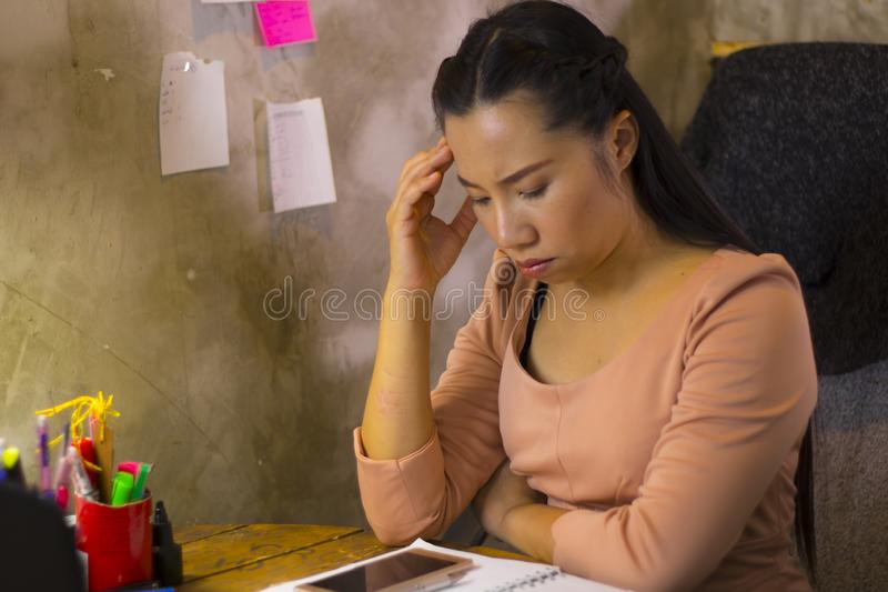 Asian woman worker suffering from hurt,fatigue, pain at neck, muscle, stressed during working with laptop for a long time, Office. Asian woman worker suffering royalty free stock image