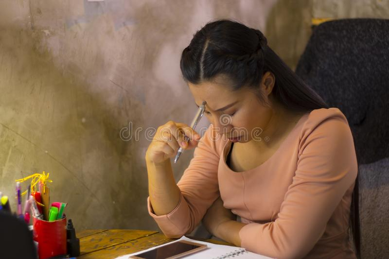 Asian woman worker suffering from hurt,fatigue, pain at neck, muscle, stressed during working with laptop for a long time, Office. Asian woman worker suffering stock photo