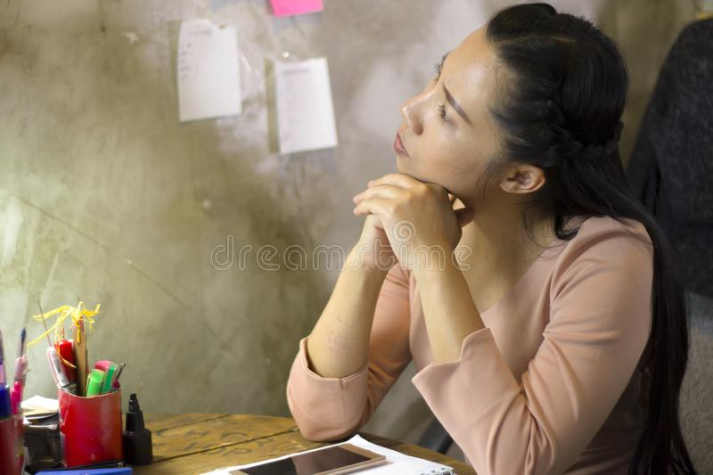 Asian woman worker suffering from hurt,fatigue, pain at neck, muscle, stressed during working with laptop for a long time, Office royalty free stock images