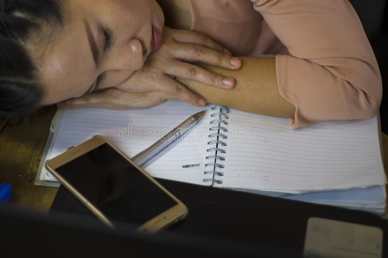 Asian woman worker suffering from hurt,fatigue, pain at neck, muscle, stressed during working with laptop for a long time, Office royalty free stock image