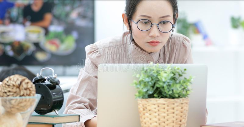 Asian woman working on laptop at home . royalty free stock photos