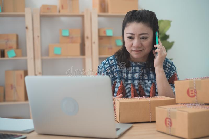 Asian woman working on laptop at home office. Close up portrait stock image