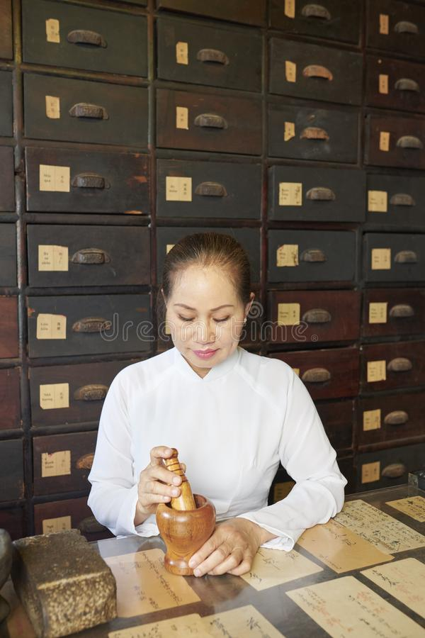 Asian woman working at tradional pharmacy royalty free stock images