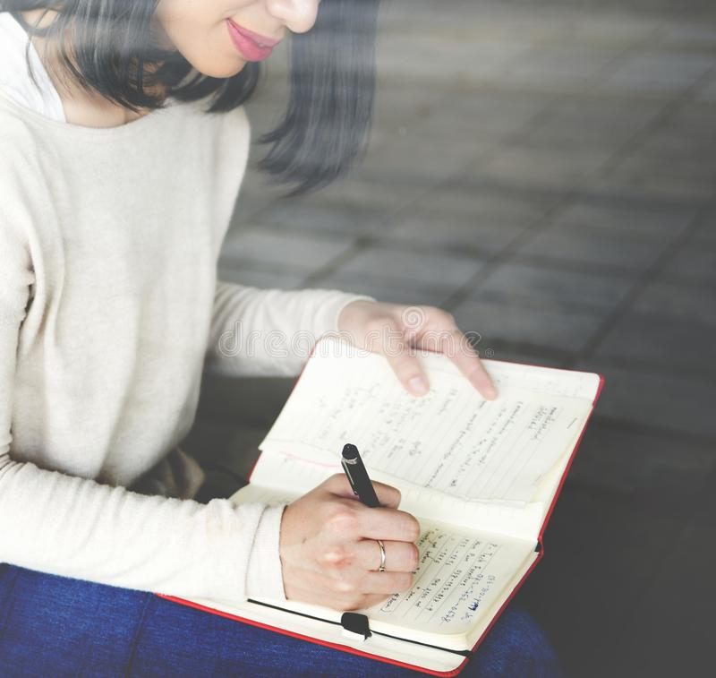 Asian woman writing notes concept stock image
