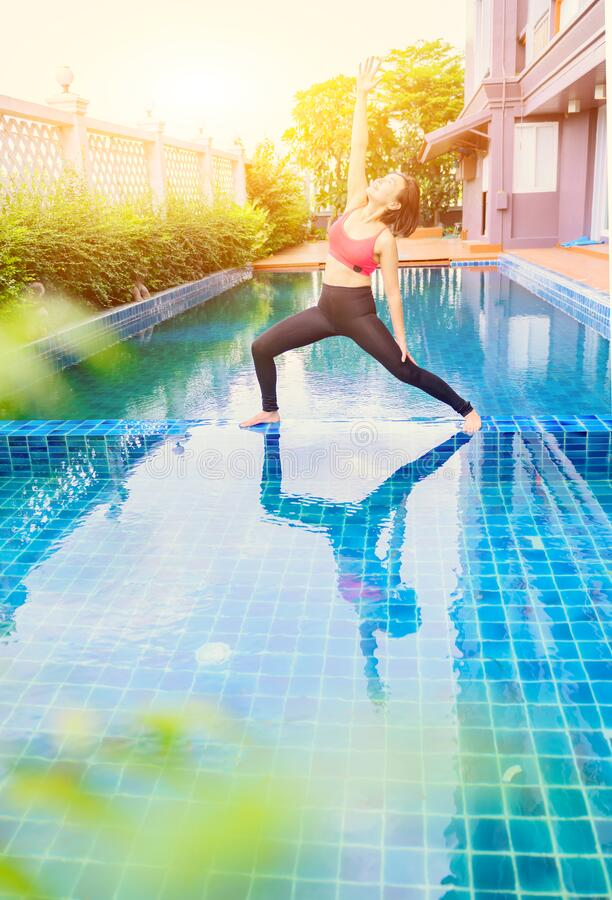 Asian Woman Yoga Breathing And Meditation Alone At Swimming Pool At Home Outdoor Exercise And Workout For Healthy Stock Image Image Of Smart Power 200181939