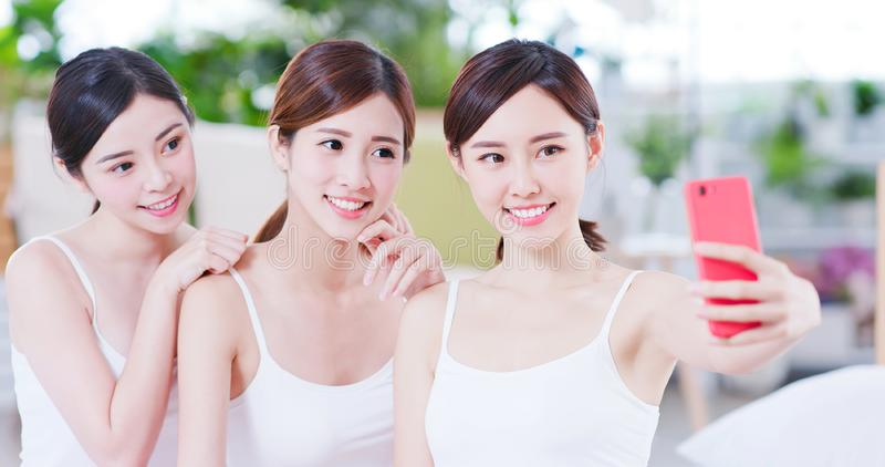 Asian womans take selfie happily royalty free stock photography