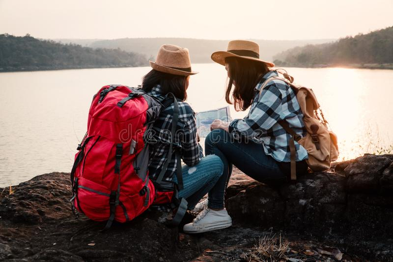 Asian women backpack on the park journey and traveling on holiday royalty free stock photos