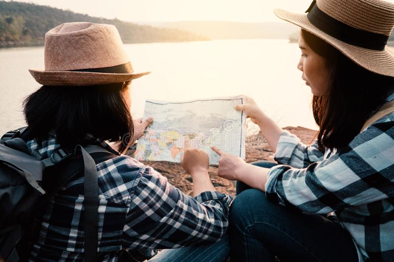 Asian women backpack on the park journey and traveling on holiday stock image