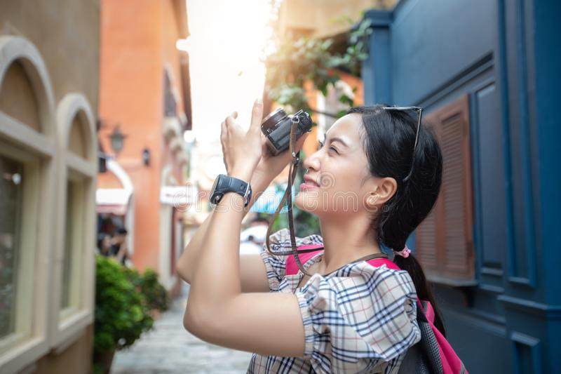 Asian women backpacks walking together and happy are taking pho stock photos