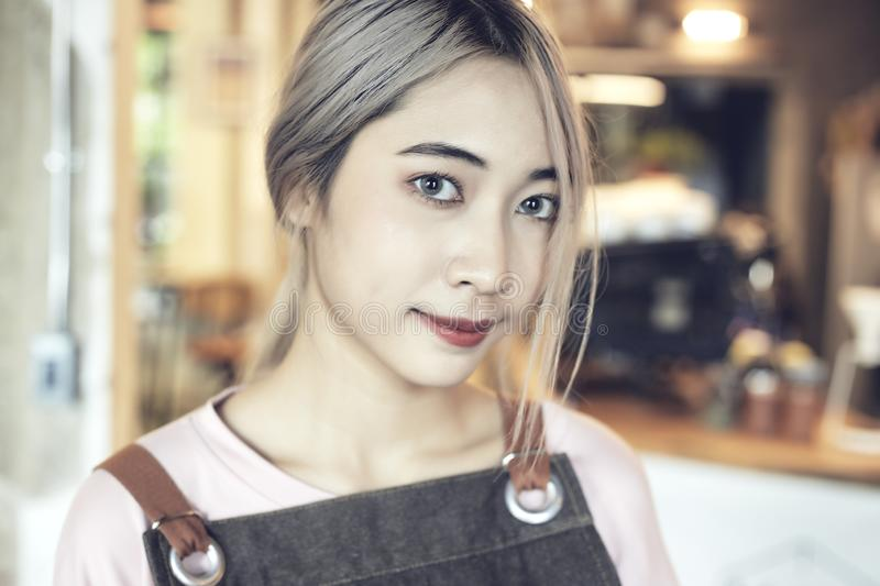 Asian Women barista At Cafe stock image