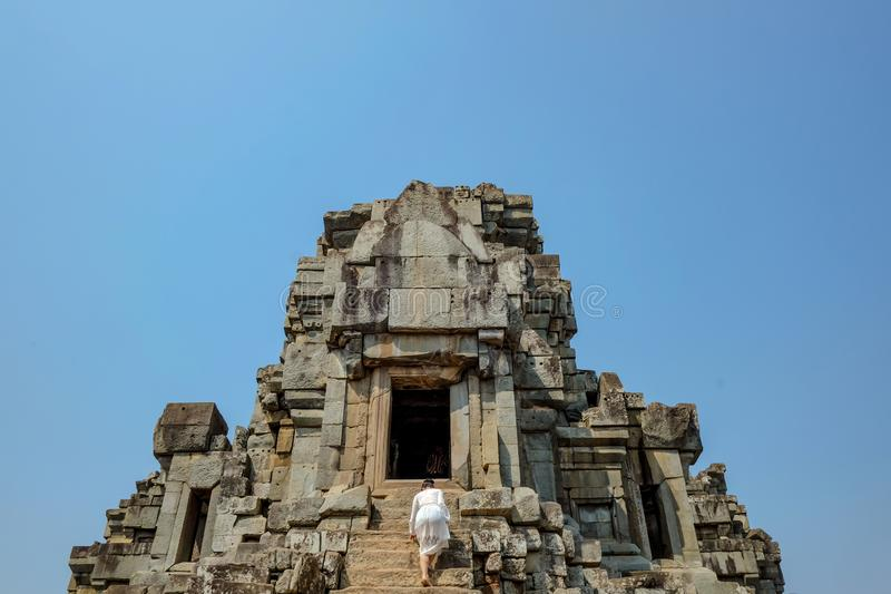 Asian women climb up to Ancient stone castle stock photos