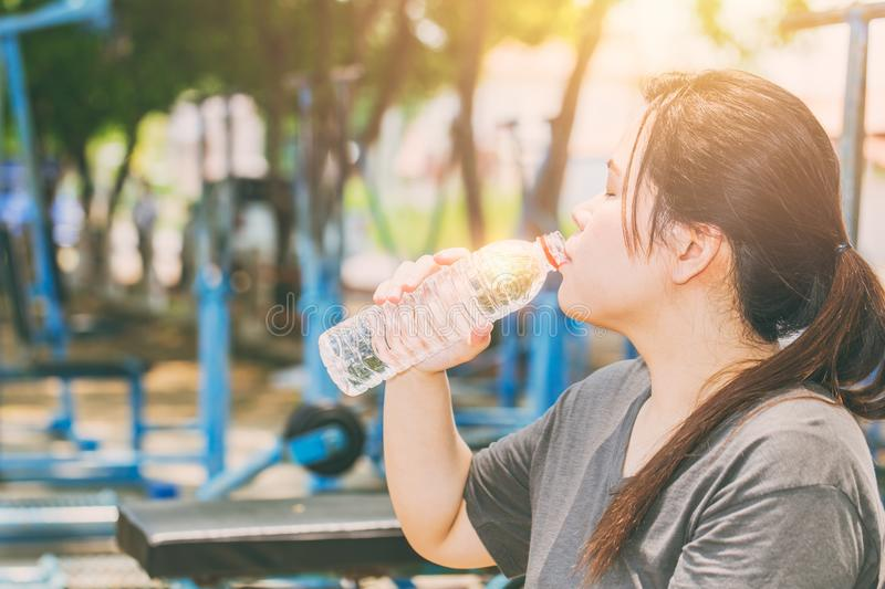 Asian women drinking water in hot day stock photos