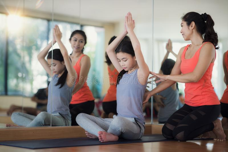 Asian woman fitness coach teach her student royalty free stock photo
