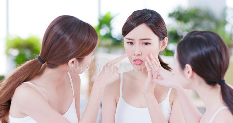 Asian women worry her skin royalty free stock images