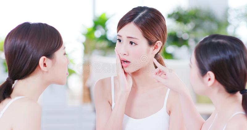 Asian women worry her skin royalty free stock image