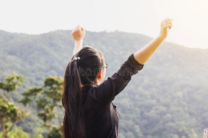 Asian women or girl raise arms open to sky with mountain and for royalty free stock photography