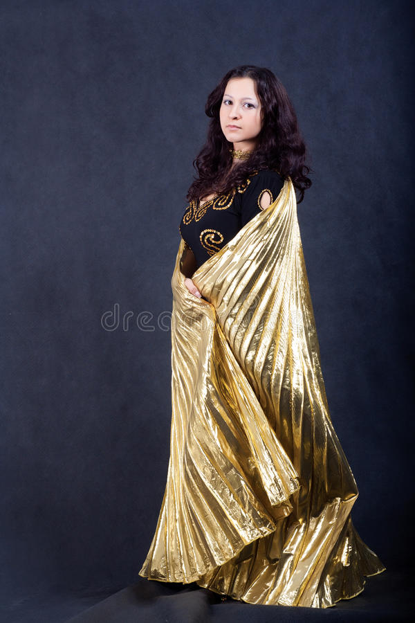 Asian Women With Gold Wings Stock Photography