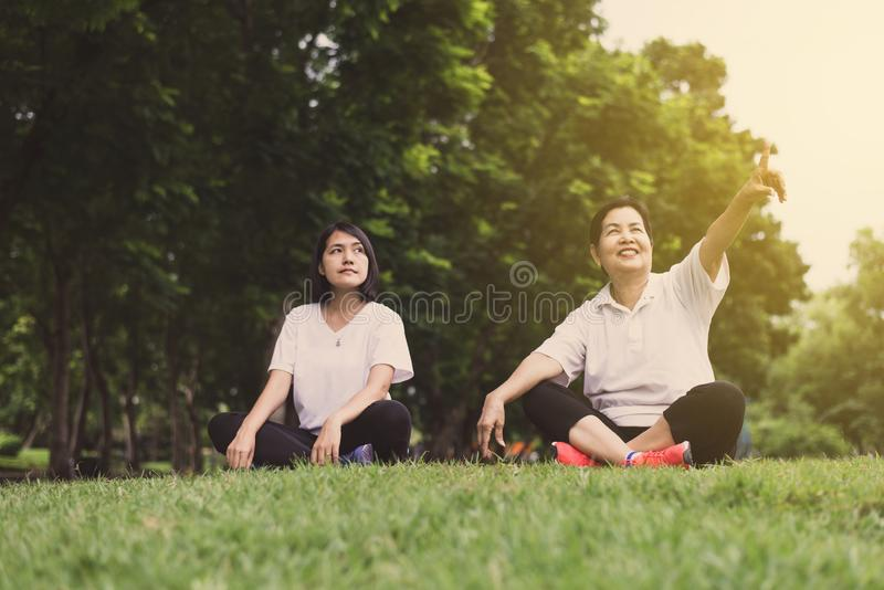Asian women hands pointing something and relax at public park in the morning together,Happy and smiling,Positive thinking,Healthy. And lifestyle concept stock images
